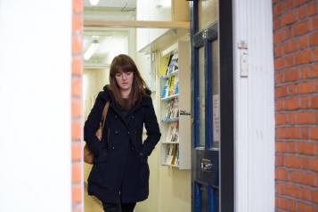 Lady walking through doorway
