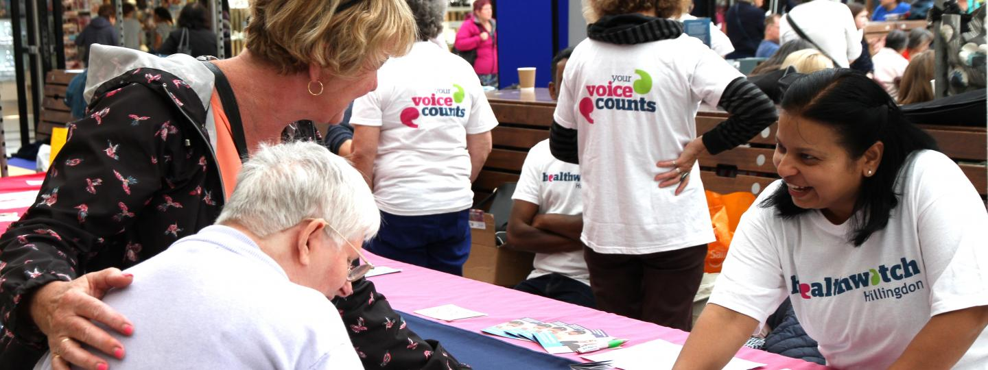 Healthwatch Volunteer with members of the public