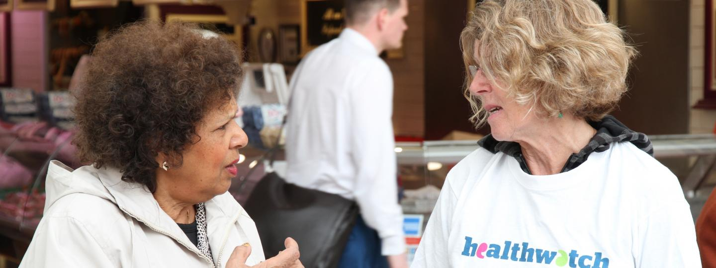 Healthwatch volunteer talking to member of the public